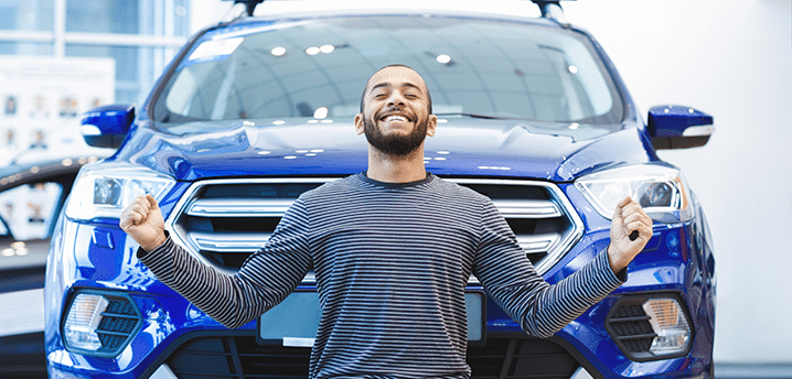 Guy in striped shirt excited about buying a new car | How To Save Money on a New Car