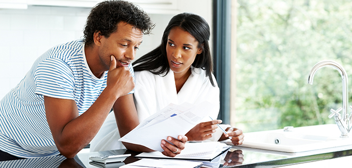 couple figuring out paying off credit card or auto loan first