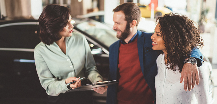 Couple evaluating joint vs cosigned auto loan options