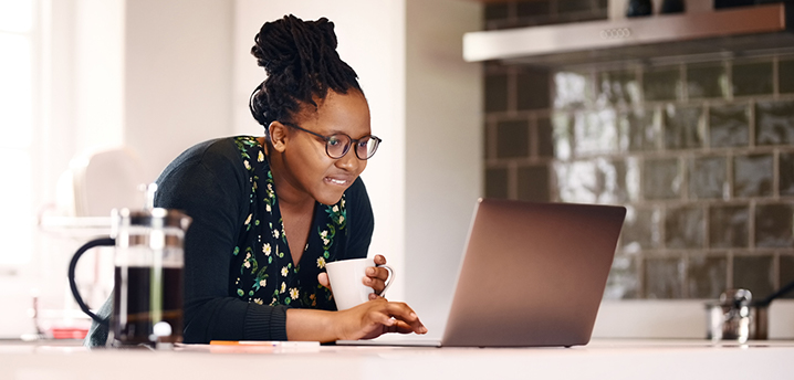 woman researching prepayment penalty for car loan on laptop