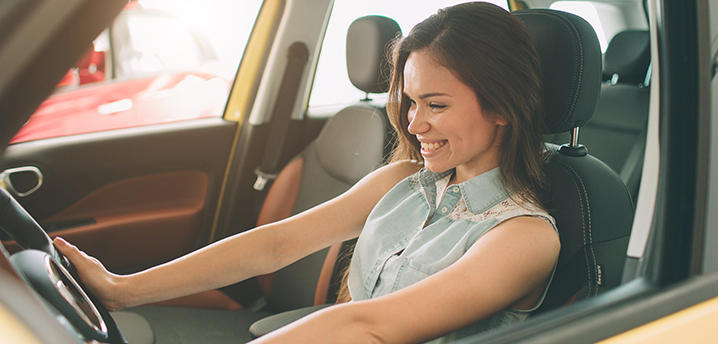 woman sitting in car thinking about what credit score needed to refinance